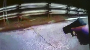 University of Cincinnati police officer Ray Tensing's body camera shows his handgun drawn after driver Samuel Dubose was pulled over and shot during a traffic stop in Cincinnati, Ohio July 19, 2015, in a still image from video released by the Hamilton County Prosecutor's Office on July 29, 2015. A University of Cincinnati police officer who fatally shot an unarmed black man has been charged with murder after a grand jury investigation, the Hamilton County prosecutor said on Wednesday.  REUTERS/Hamilton County Prosecutor's Office/Handout via Reuters FOR EDITORIAL USE ONLY. NOT FOR SALE FOR MARKETING OR ADVERTISING CAMPAIGNS. THIS IMAGE HAS BEEN SUPPLIED BY A THIRD PARTY. IT IS DISTRIBUTED, EXACTLY AS RECEIVED BY REUTERS, AS A SERVICE TO CLIENTS - RTX1MBI8