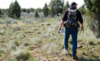 Troy Capps carries deer antlers he found in Central Oregon. Photo by Courtney Flatt/NWPR/EarthFix
