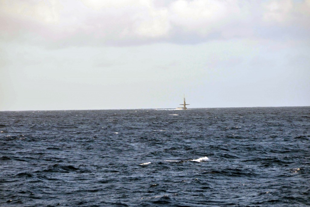 The USS Pennsylvania is a ballistic missile carrying submarine. Here it is approaching the Malama, a Personnel Transfer Vessel. Photo by Dan Sagalyn