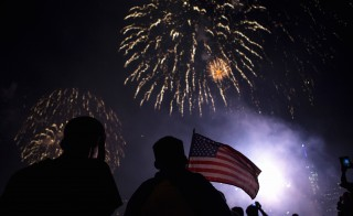 Spectators watch the Macy's Fourth of July fireworks explode over the East River in New York, July 4, 2014. New studies show that fireworks may adversely affect peoples' health because of the high levels of pollutants they release into the air. Photo by Eric Thayer/Reuters