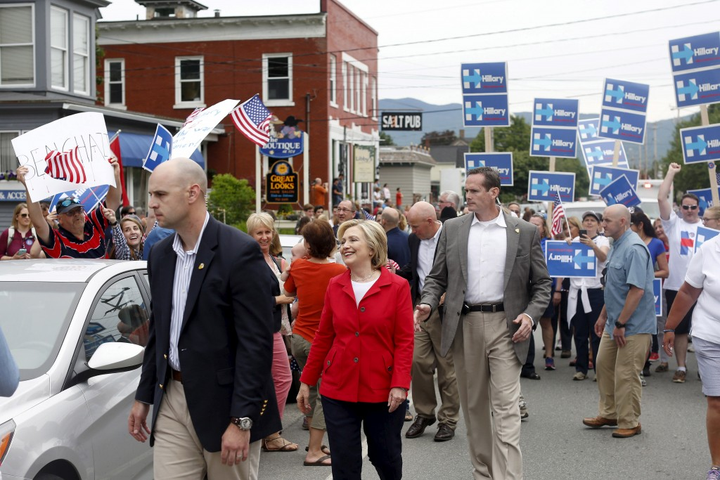 Former United States Secretary of State and Democratic candidate for president Hillary Clinton walks in the Fourth of July Parade in Gorham, New Hampshire, July 4, 2015. Clinton's campaign has sought out dozens of policy experts to help craft her platform.  Photo by Dominick Reuter/Reuters