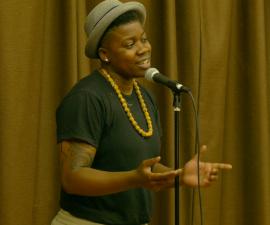 """Janae Johnson performs her poem """"Magic."""" Image courtesy of SlamFind."""