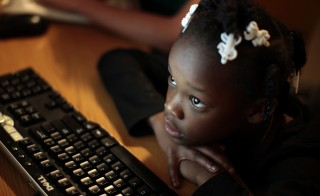 Jayla studies on a computer at the shelter where she lives in Los Angeles, California February 9, 2011. School on Wheels uses volunteers to tutor homeless children in shelters, parks, motels, and two centers. There has been a surge in the number of homeless children in Los Angeles in the last five years, due to persistent unemployment and mounting foreclosures. Picture taken February 9, 2011.  REUTERS/Lucy Nicholson (UNITED STATES - Tags: SOCIETY EDUCATION) - RTR2JZUO