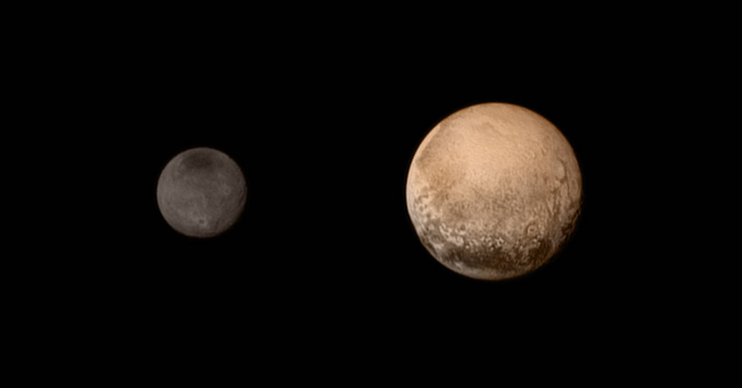 Pluto and Charon. Photo by NASA/JHUAPL/SWRI