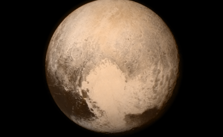 Pluto nearly fills the frame in this image from the Long Range Reconnaissance Imager (LORRI) aboard NASA's New Horizons spacecraft, taken on July 13, 2015 when the spacecraft was 476,000 miles (768,000 kilometers) from the surface. This is the last and most detailed image sent to Earth before the spacecraft's closest approach to Pluto on July 14.  Image by NASA/APL/SwRI