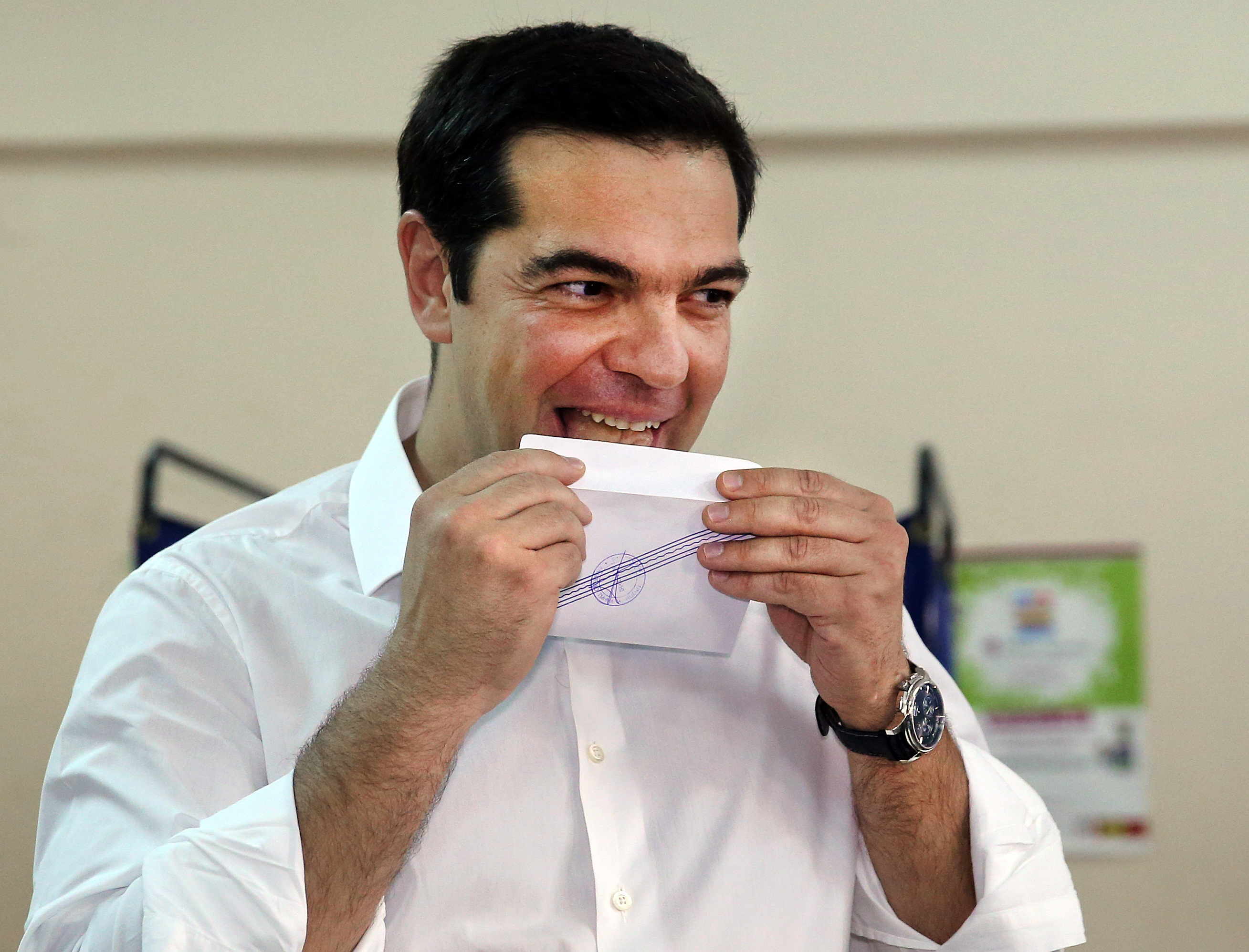 Greek Prime Minister Alexis Tsipras licks his ballot envelope before voting at a polling station in Athens, Greece, on July 5, 2015. Greece voted on Sunday on whether to accept more austerity in exchange for international aid, in a high-stakes referendum likely to determine whether it leaves the eurozone after seven years of economic pain. Photo by Alkis Konstantinidis/Reuters