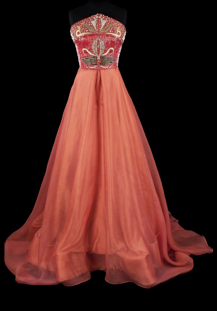 Orlando Dugi, evening gown (from the Red Collection), Santa Fe, New Mexico, 2014. Hand-dyed silk duchesse satin, silk organza, and silk thread; cut glass and sterling silver beads, French coil, Swarovski crystals, vintage beads and crystals; lining of duchesse satin and tulle, 63 x 52 in. Collection of the artist. Photo by Blair Clark.