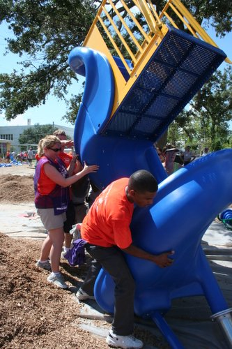 Volunteers help erect a playground for the Second Street Elementary School in Bay St. Louis, Mississippi, in August 2006. Photo courtesy of KaBOOM!