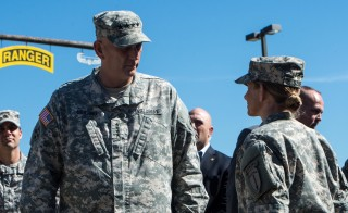 U.S. Army Chief of Staff Gen. Ray Odierno speaks with a female Soldier at the Army Ranger Training Brigade, Ranger Assessment Course during his visit to Fort Benning, Georgia on Oct. 23, 2014. Two women will make history Friday by becoming the first females to graduate from the Army's Ranger School and its grueling combat training program. Photo by Staff Sgt. Mikki L. Sprenkle/U.S. Army