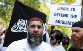 Muslim cleric Anjem Choudary leads a protest against the killing of Osama bin Laden outside the U.S. Embassy in London on May 6, 2011. A rival rally by the English Defense League celebrating the death of the al-Qaida leader was nearby. Photo by Oli Scarff/Getty Images