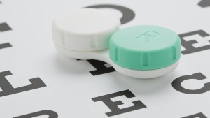 Studio shot of contact lens case on eye chart