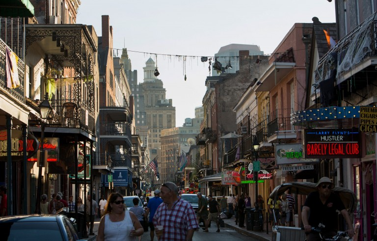 Pedestrians walk along Bourbon Street in the French Quarter neighborhood of New Orleans, Louisiana, U.S., on Tuesday, Oct. 21, 2014. New Orleans, one of the largest and busiest ports in the world, accounts for a significant portion of the nation's oil refining and petrochemical production. Photographer: Samantha Kaplan/Bloomberg via Getty Images