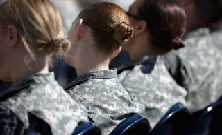 ARLINGTON, VA - MARCH 31:  Soldiers, officers and civilian employees attend the commencement ceremony for the U.S. Army's annual observance of Sexual Assault Awareness and Prevention Month in the Pentagon Center Courtyard March 31, 2015 in Arlington, Virginia. In conjunction with the national campaign against sexual assault, The Army announced this year's theme, 'Not in My Squad. Not in Our Army. We are Trusted Professionals,' during the ceremony.Ê According to the Pentagon, the initative 'is a grassroots approach meant to reinforce a climate of dignity and respect founded on good order and discipline.'  (Photo by Chip Somodevilla/Getty Images)