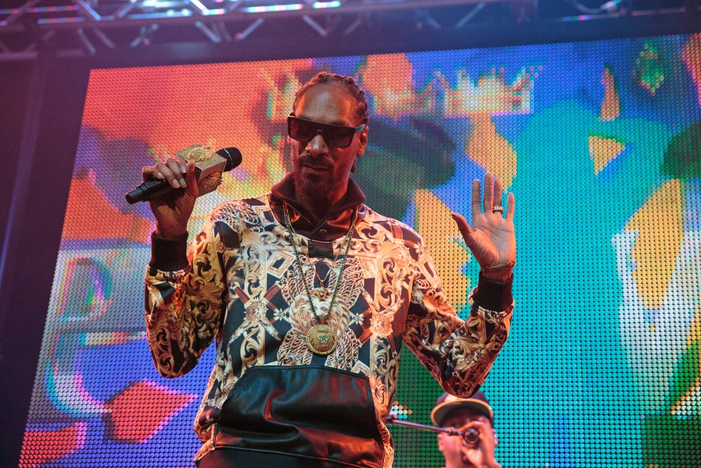 "Snoop Lion, a.k.a. Snoop Dogg, performs onstage at The Vogue on Feb. 22, 2014 in Indianapolis, Indiana. Rappers and other performers have been doing the ""mic drop"" since the 1980s, and as of August 2015 the term is now in the Oxford Dictionaries' lexicon. Photo by Joey Foley/Getty Images"