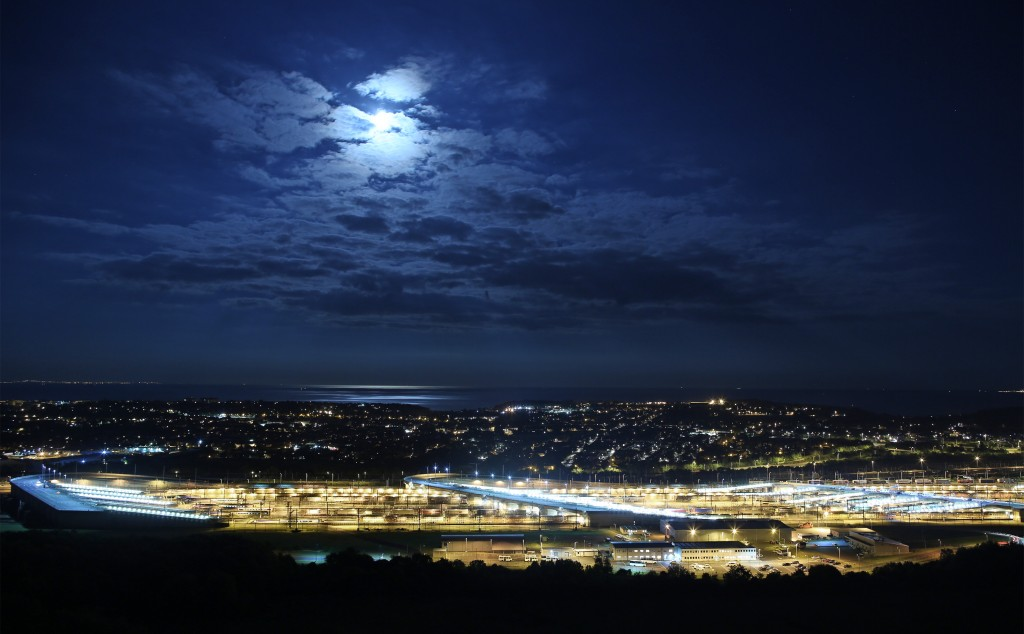 The Eurotunnel terminal is illuminated by the blue moon on July 31, 2015 in Folkestone, England. Photo by Peter Macdiarmid/Getty Images.