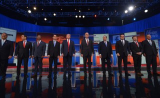 The top 10 Republican presidential hopefuls arrive on stage for the start of the prime time Republican presidential primary debate on August 6, 2015 at the Quicken Loans Arena in Cleveland, Ohio. AFP PHOTO/MANDEL NGAN        (Photo credit should read MANDEL NGAN/AFP/Getty Images)