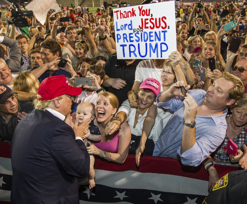 Republican presidential candidate Donald Trump greets supporters after his rally at Ladd-Peebles Stadium on August 21, 2015 in Mobile, Alabama. The Trump campaign moved tonight's rally to a larger stadium to accommodate demand. (Photo by Mark Wallheiser/Getty Images)