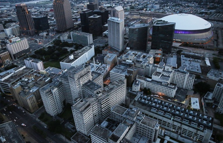 NEW ORLEANS, LA - AUGUST 24:  The Mercedes-Benz Superdome stands (Top R) downtown near the abandoned Charity Hospital (Lower L), which was flooded during Hurricane Katrina and never re-opened, on August 24, 2015 in New Orleans, Louisiana. The Superdome site was used as a 'shelter of last resort' during Hurricane Katrina. The tenth anniversary of Hurricane Katrina, which killed at least 1836 and is considered the costliest natural disaster in U.S. history, is August 29.  (Photo by Mario Tama/Getty Images)