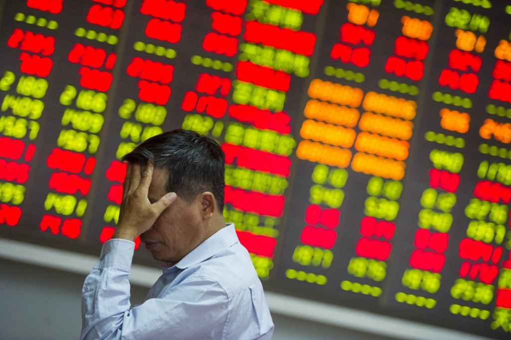 HAIKOU, CHINA - AUGUST 26:  (CHINA OUT) An investor reacts at a stock exchange hall on August 26, 2015 in Haikou, China. Chinese shares plunged on Wednesday with the benchmark Shanghai Composite Index down 37.68 points, or 1.27 percent, to close at 2,927.29. The Shenzhen Component Index fell 298.22 points, or 2.92 percent, to close at 9,899.72.  (Photo by Luo Yunfei/CNSPHOTO/ChinaFotoPress/ChinaFotoPress via Getty Images)