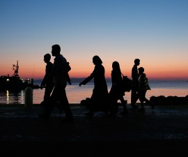KOS, GREECE - AUGUST 30:  A migrant family from Syria walks to the port for transit to Athens at sunrise on August 30, 2015 in Kos, Greece. From Kos, many migrants journey north to Athens and then the Greek border town of Idomeni before crossing into Macedonia. Since the beginning of 2015 the number of migrants using the so-called 'Balkans route' has exploded with migrants arriving in Greece from Turkey and then travelling on through Macedonia and Serbia before entering the EU via Hungary. The number of people leaving their homes in war torn countries such as Syria, marks the largest migration of people since World War II.  (Photo by Win McNamee/Getty Images)