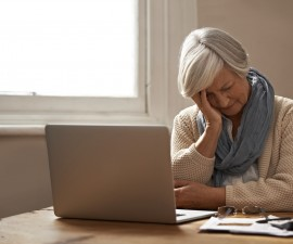Senior woman frustrated with Social Security.  Photo by PeopleImages.com/Getty Images