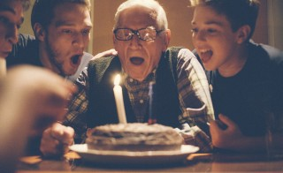 Young men celebrating their grandfathers birthday. Photo by WIN-Initiative/Getty Images
