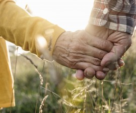 close up of mature couple hands holding in meadow. Related words: Social Security, Medicare, senior, Photo by Buero Monaco/Getty Images