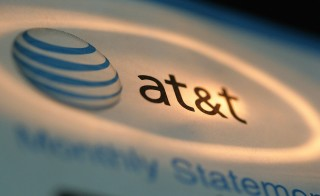 DES PLAINES, IL - MAY 12:  The AT&T logo is seen atop a phone bill May 12, 2006 in Des Plaines, Illinois. The US National Security Agency began collecting information from phone records of millions of AT&T (until recently known as SBC), Verizon, and BellSouth customers shortly after the 2001 terror attacks. Questioning the legality, Qwest refused to comply with the agency's request for records.  (Photo Illustration by Tim Boyle/Getty Images)