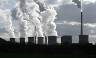 GERMANY - MARCH 05:  Smokestacks and cooling towers emit smoke and water vapor at the E.ON-owned Scholven coal-powered electricity plant near Gelsenkirchen, Germany, on Wednesday, March 5, 2008. E.ON AG, Germany's largest utility, reported a drop in fourth-quarter profit because of tax gains the previous year.  (Photo by Wolfgang Von Brauchitsch/Bloomberg via Getty Images)