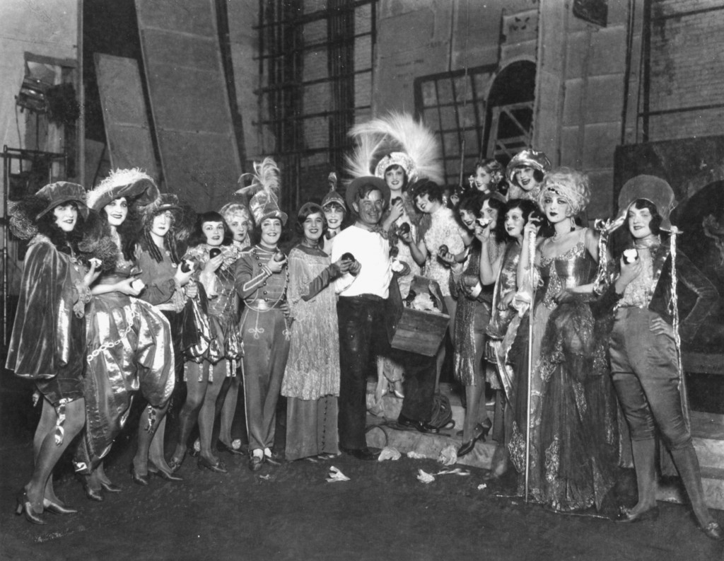 Will Rogers backstage with 1924 Ziegfeld Follies cast. Image provided by Will Rogers Memorial Museum