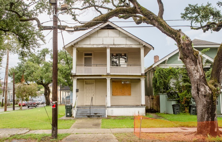 The Boyst Town Louisiana group house where Herman and Yvonne Clayton lived with Dedera Johnson remains boarded up 10 years after Hurricane Katrina made landfall over New Orleans. Floodwaters spared the house, but wind and rain damage made the home uninhabitable. Photo by Josh Brasted