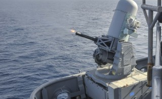 A Phalanx close-in weapons system fires during a live exercise aboard the amphibious assault ship USS Boxer. U.S. Navy photo by Mass Communication Specialist 3rd Class Jesse Monford/Released