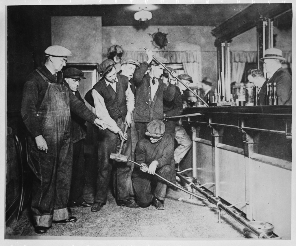 Prohibition agents destroying a bar, ca. 1930National Archives, Records of the U.S. Information Agency