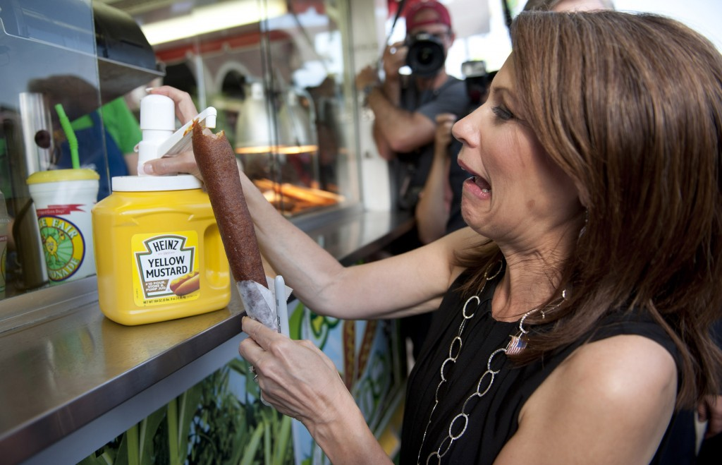 U.S. Republican presidential candidate and Minnesota Congresswoman Michele Bachmann enjoys mustard on her corn dog at the Iowa State Fair in Des Moines, Iowa, Aug. 12, 2011. Photo by Daniel Acker/Reuters