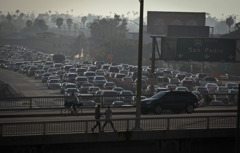 Traffic is backed up in all directions as it moves through downtown on Interstate 110 in Los Angeles, California on March 22, 2012. Photo by Bret Hartman/Reuters