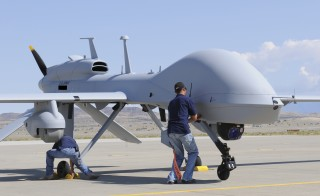 Workers prepare an MQ-1C Gray Eagle unmanned aerial vehicle for static display at Michael Army Airfield, Dugway Proving Ground in Utah in this Sep. 15, 2011 U.S. Army handout photo obtained by Reuters. Photo by Spc. Latoya Wiggins/Handout via U.S. Army