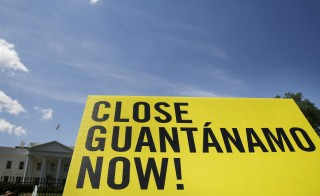 A sign calling for the closure of the U.S.-run Guantanamo Bay prison in Cuba is seen at a rally next to the White House in Washington D.C. on May 23, 2014. The Defense Department is looking at alternatives to Guantanamo Bay as part of the Obama administration's push to close the prison.   Photo by Larry Downing/Reuters