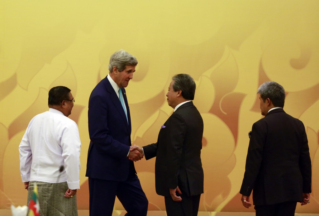 U.S. Secretary of State John Kerry (2nd L) shakes hands with Malaysia's Foreign Minister Anifah Aman as Myanmar's Foreign Minister Wanna Muang Lwin (L) and Brunei's Foreign Minister Prince Mohamed Bolkiah (R) looks on during the ASEAN-U.S. Ministerial Meeting at Myanmar International Convention Centre (MICC) in Naypyitaw on August 9, 2014. Malaysia, among other countries in the area, have been highlighted as hot spots for human trafficking, especially as standards of prosecution and prevention are continuously unmet. Photo by Soe Zeya Tun/Reuters