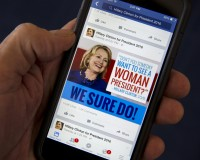 A mobile phone shows a Facebook page promoting Hillary Clinton for president in 2016, in this photo illustration taken April 13, 2015. By one estimate U.S. online political advertising could quadruple to nearly $1 billion in the 2016 election, creating huge opportunities for digital strategy firms eager to capitalize on a shift from traditional mediums like television. REUTERS/Mike Segar - RTR4X893