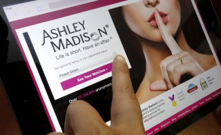 The homepage of the Ashley Madison website is displayed on an iPad in this photo illustration taken in Ottawa, Canada on July 21. Photo by Chris Wattie/Reuters