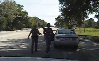Texas state trooper Brian Encinia points a Taser as he orders Sandra Bland out of her vehicle, in this still image captured from the police dash camera video from the traffic stop of Bland's vehicle in Prairie View, Texas, July 10, 2015. A Texas lawmaker who met with the family of a black woman found dead in her jail cell after her arrest following a routine traffic stop said on July 21, 2015 she should never have been in police custody in the first place. Democratic State Senator Royce West told a news conference there would be no cover-up in the investigation of the death of Sandra Bland, a 28-year-old Chicago-area woman, three days after she was arrested in Prairie View, Texas, northwest of Houston.  REUTERS/The Texas Department of Public Safety/Handout via Reuters    ATTENTION EDITORS - THIS PICTURE WAS PROVIDED BY A THIRD PARTY. REUTERS IS UNABLE TO INDEPENDENTLY VERIFY THE AUTHENTICITY, CONTENT, LOCATION OR DATE OF THIS IMAGE. THIS PICTURE IS DISTRIBUTED EXACTLY AS RECEIVED BY REUTERS, AS A SERVICE TO CLIENTS. FOR EDITORIAL USE ONLY. NOT FOR SALE FOR MARKETING OR ADVERTISING CAMPAIGNS. - RTX1LA6N