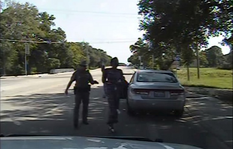 Texas state trooper Brian Encinia points a Taser as he orders Sandra Bland out of her vehicle, in this still image captured from the police dash camera video from the traffic stop of Bland's vehicle in Prairie View, Texas, July 10, 2015. A Texas lawmaker who met with the family of a black woman found dead in her jail cell after her arrest following a routine traffic stop said on July 21, 2015 she should never have been in police custody in the first place. Democratic State Senator Royce West told a news conference there would be no cover-up in the investigation of the death of Sandra Bland, a 28-year-old Chicago-area woman, three days after she was arrested in Prairie View, Texas, northwest of Houston.  REUTERS/The Texas Department of Public Safety/Handout via ReutersATTENTION EDITORS - THIS PICTURE WAS PROVIDED BY A THIRD PARTY. REUTERS IS UNABLE TO INDEPENDENTLY VERIFY THE AUTHENTICITY, CONTENT, LOCATION OR DATE OF THIS IMAGE. THIS PICTURE IS DISTRIBUTED EXACTLY AS RECEIVED BY REUTERS, AS A SERVICE TO CLIENTS. FOR EDITORIAL USE ONLY. NOT FOR SALE FOR MARKETING OR ADVERTISING CAMPAIGNS. - RTX1LA6N