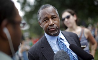 "Republican presidential candidate Dr. Ben Carson talks to reporters after speaking at the ""Women Betrayed Rally to Defund Planned Parenthood"" at Capitol Hill in Washington July 28, 2015.  REUTERS/Carlos Barria - RTX1M68E"