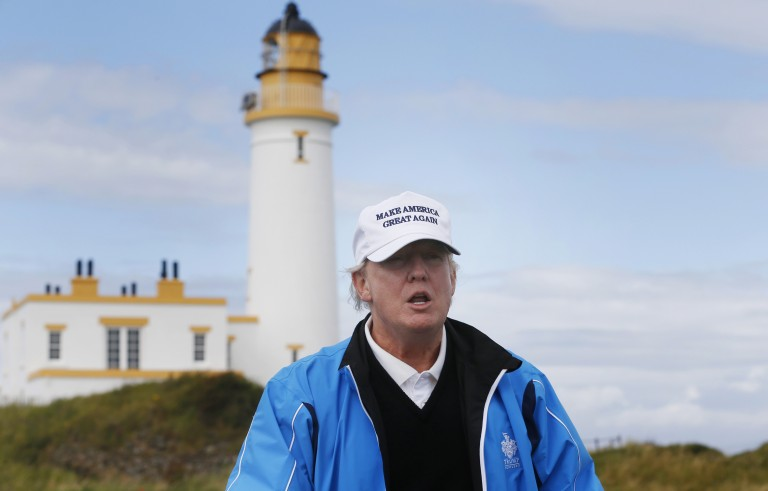 Presidential Candidate Donald Trump views his Scottish golf course at Turnberry, Aug. 1, 2015. A review of Trump's financial records and other government filings found that the billionaire candidate doesn't rank among the country's most generous citizens in terms of charitable donations. Photo by Russell Cheyne/Reuters