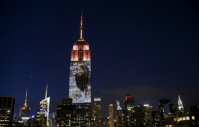 An image of Cecil the lion is projected onto the Empire State Building as part of an endangered species projection to raise awareness, in New York August 1, 2015. Photo by Eduardo Munoz/Reuters.
