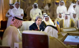 U.S. Secretary of State John Kerry (C) listens while Oman's Foreign Minister Yusuf bin Alawi (L) speaks during a meeting of foreign ministers of the Gulf Cooperation Council (GCC) in Doha August 3, 2015. Kerry is meeting his Gulf Arab counterparts for talks in Qatar as he attempts to ease the concerns of key allies over the Iran nuclear deal. REUTERS/Brendan Smialowski/Pool? - RTX1MU1L