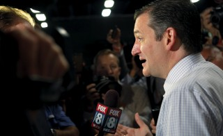 Republican presidential candidate and U.S. Senator Ted Cruz talks to reporters in the media center at the site of the first official Republican presidential candidates debate of the 2016 U.S. presidential campaign in Cleveland, Ohio, August 6, 2015.  REUTERS/Brian Snyder - RTX1ND9E