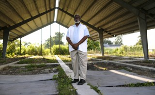 Rev. Charles Duplessis at the construction site of his fellowship's new church, the Mount Nebo Bible Baptist Church, in the Lower Ninth Ward. Photo by Jonathan Bachman/Reuters