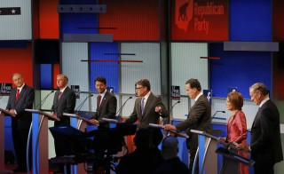 Republican presidential candidates (L-R), former Virginia Governor Jim Gilmore, U.S. Senator Lindsey Graham, Louisiana Governor Bobby Jindal, former Texas Governor Rick Perry, former U.S. Senator Rick Santorum, former HP CEO Carly Fiorina and former New York Governor George Pataki, debate at a Fox-sponsored forum for lower polling candidates held before the first official Republican presidential candidates debate of the 2016 U.S. presidential campaign in Cleveland, Ohio, August 6, 2015. Photo by Brian Snyder/Reuters