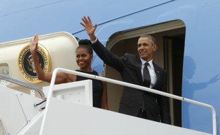 President Barack Obama and first lady Michelle Obama board Air Force One as they depart Joint Base Andrews in Washington, August 7, 2015. In an interview aired Sunday, Obama said a constructive relationship with Iran was a possible byproduct of the Iran nuclear deal, but that such a development wouldn't be immediate or guaranteed. Photo by Kevin Lamarque/Reuters